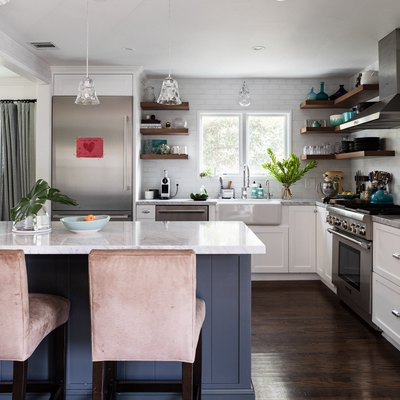 small kitchen with peninsula, subway tile, stainless steel appliances
