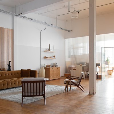 open loft living space with wood floors, tall ceilings