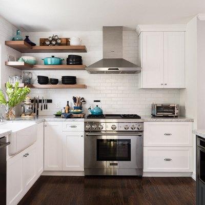 airy kitchen with exposed shelves, dark wood floor, white cabinetry, white tile backsplash