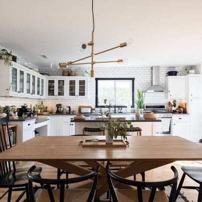 large kitchen with focus on wood dining room table