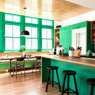 green kitchen with wood flooring and countertop