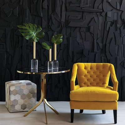 yellow tufted chair