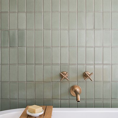 light green ceramic tile on the bathroom wall