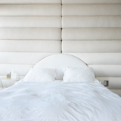 White pillows and sheets on bed