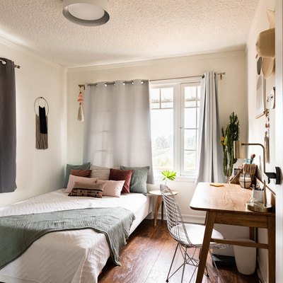 neutral-colored bedroom with hardwood floors