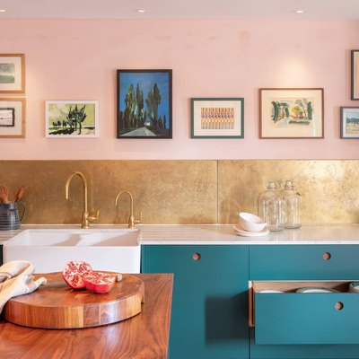 Should Wall Color Match Kitchen Cabinets in eclectic kitchen with pink walls, gold backsplash and teal cabinetry