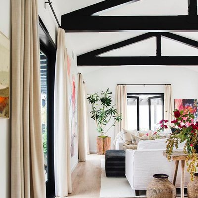 Black Beams Define an Airy and Sophisticated Living Room