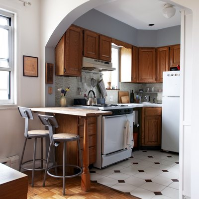 small kitchen open to dining room with an arch