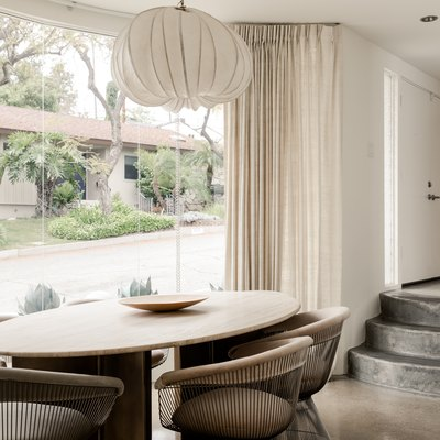 modern white dining room with vintage chairs