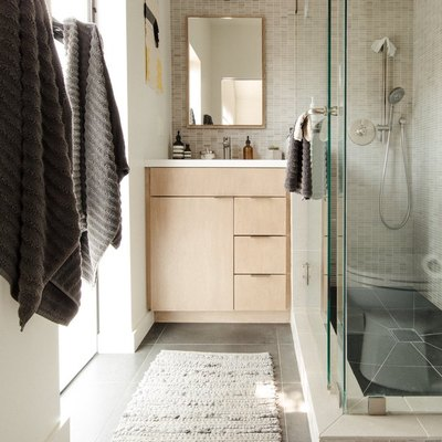 Neutral walls and flooring in a master bathroom