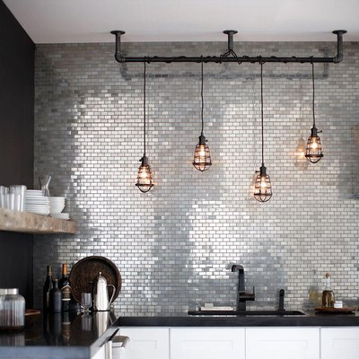 stainless steel mini subway tile backsplash in modern kitchen