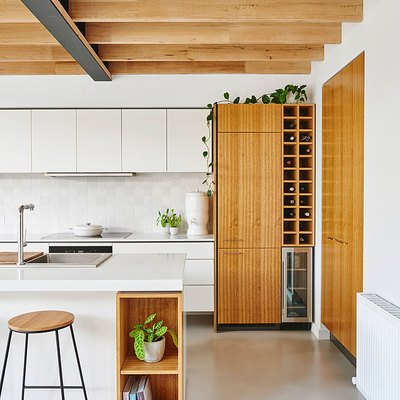 concrete kitchen flooring and exposed wood ceiling beams