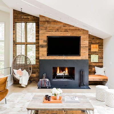 rustic fireplace with wood and black concrete