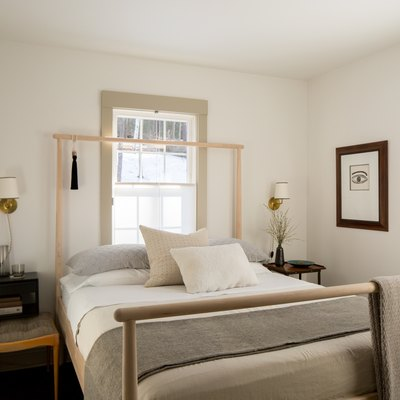 Neutral tones and textiles keep a bedroom inviting