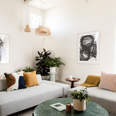 living room with rug, pendant lights, couches, concrete floors
