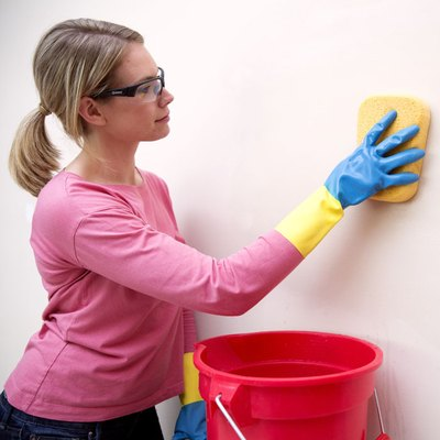 Washing walls for painting.