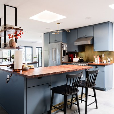 blue kitchen cabinets in a kitchen with open layout