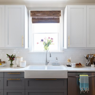 monochrome kitchen cabinets, farmhouse sink and window above sink