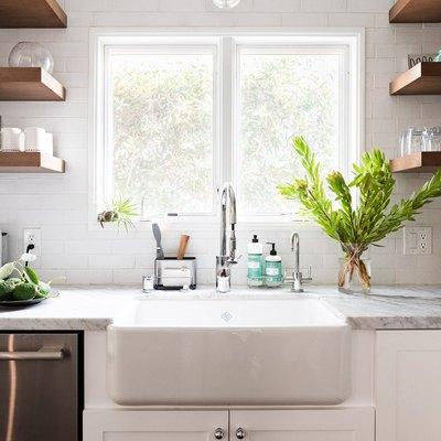 bright white kitchen with farmhouse sink, gray counter