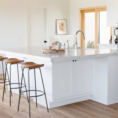 kitchen island with barstools and sink