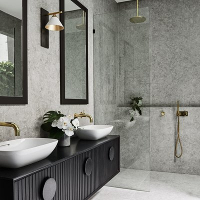 10 Stunning Stone Tile Bathroom Designs That Made Our Editors Do a Double Take