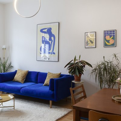 Midcentury modern living room with vintage furniture and blue couch