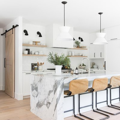 kitchen bar idea with minimal kitchen with marble countertops and leather cantilever bar stools.