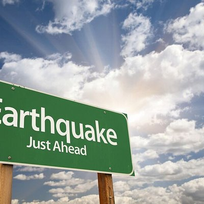 Earthquake ahead sign.
