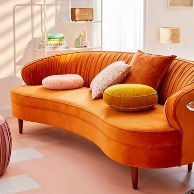 curved orange velvet sofa