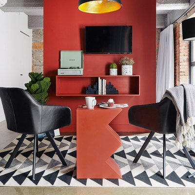 modern sitting room with red, black, and white palette