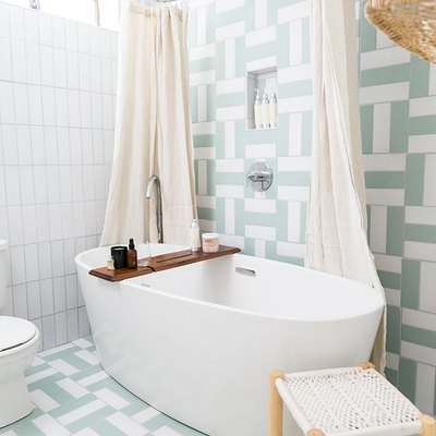light, bright bathroom with stand-alone tub and linen shower curtain by Parachute