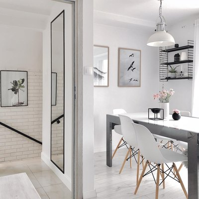 A Gray-and-White Palette Creates a Serene Scandinavian Dining Room