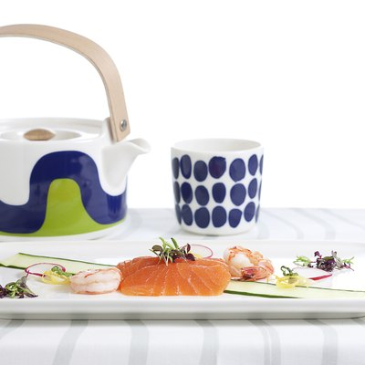 brightly-colored tea pot and cup