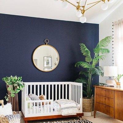 A Stunning Accent Wall Creates a Dynamic Nursery Design