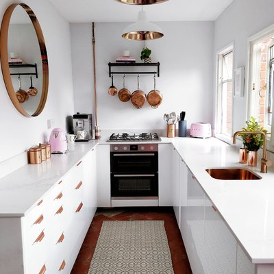 kitchen makeover with white kitchen cabinets and copper accents