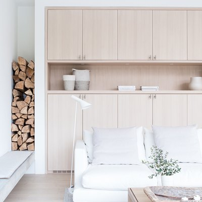 Scandinavian living room storage idea with built-in wood cabinets