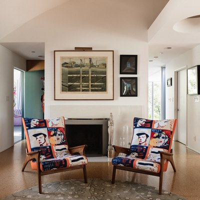 entryway with accent chairs and cork flooring
