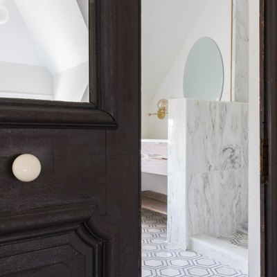 Good Bones: Restored Vintage Doors Lend Drama to a Majestic Master Bath