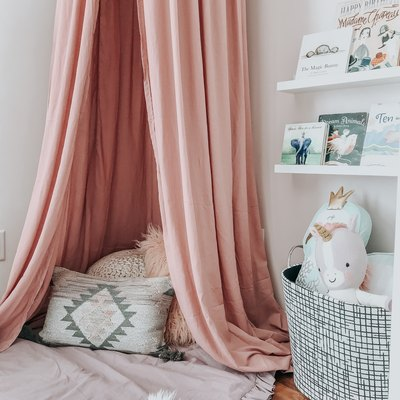 girls bedroom idea with pink ceiling canopy for reading nook