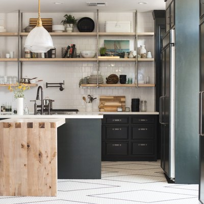 Kitchen floor tile idea with geometric shapes and black cabinets