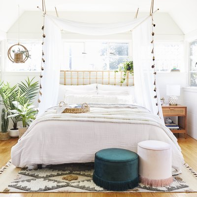 Small bedroom decorating idea with an ethereal canopy