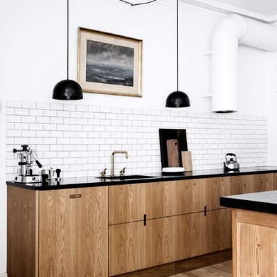 Scandinavian modern kitchen idea with black accents and sleek cabinets