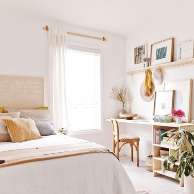 bedroom office idea with raw wood desk built into the wall of a light, neutral bedroom