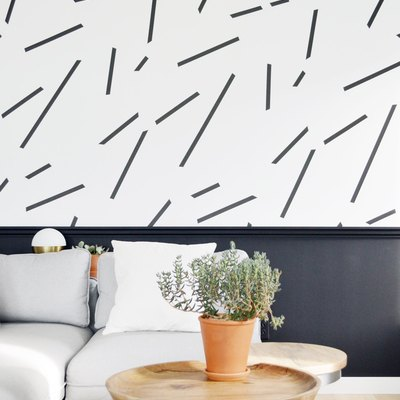 black-and-white living room idea with wainscoting and patterned wallpaper