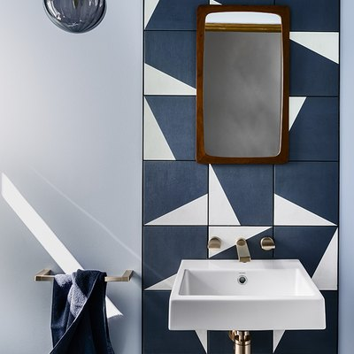 bathroom backsplash idea with geometric tile pattern and floating sink