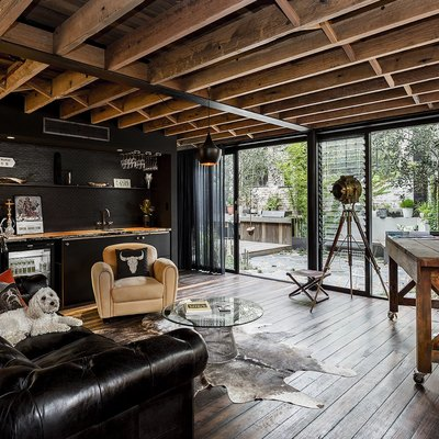 Fathers Day man cave with black walls and exposed wood rafters