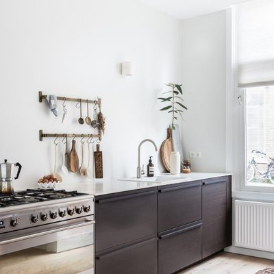 small kitchen organization idea with utensils hanging on wall