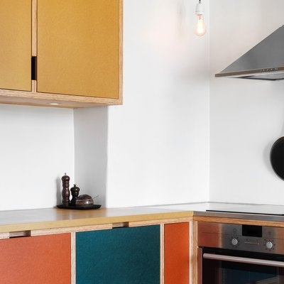 yellow kitchen cabinet idea with green and orange fronts and hanging pendant light