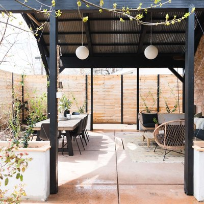 A patio before and after with wicker furniture and an outdoor rug