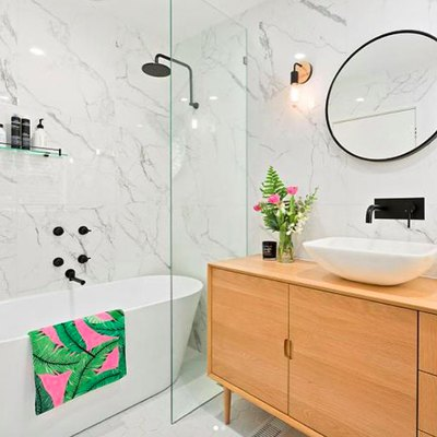 Botanical Accents Complete a Stunning Minimal Bathroom